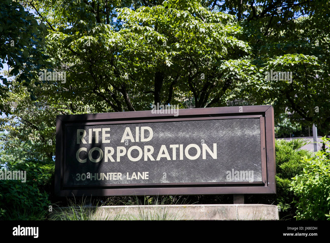 A logo sign outside of the headquarters of the Rite Aid Corporation in Camp Hill, Pennsylvania on July 30, 2017. - Stock Image