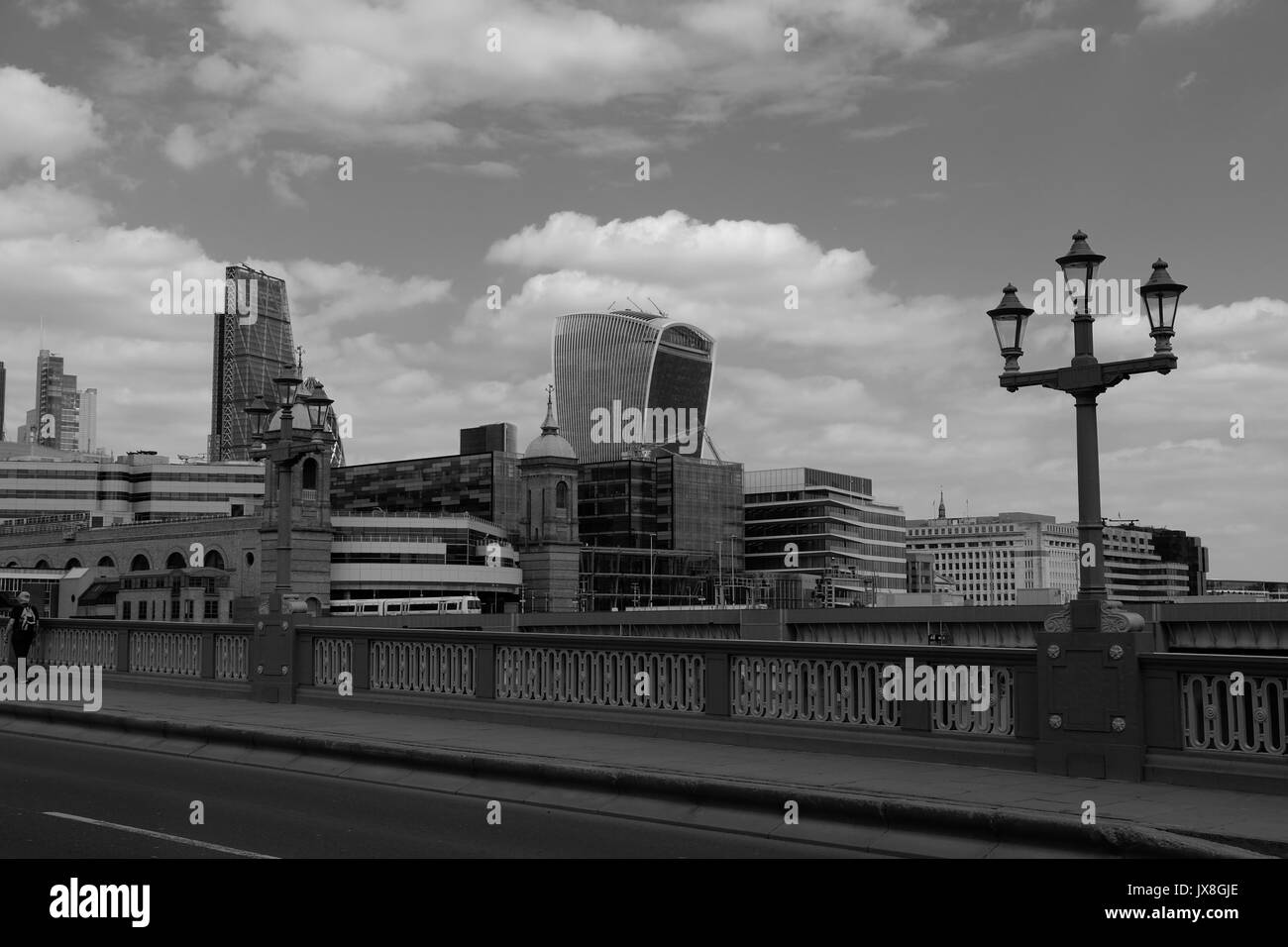 The view from Southwark Bridge showing a train leaving Cannon Street Station, and London's skyscrapers in the background. - Stock Image