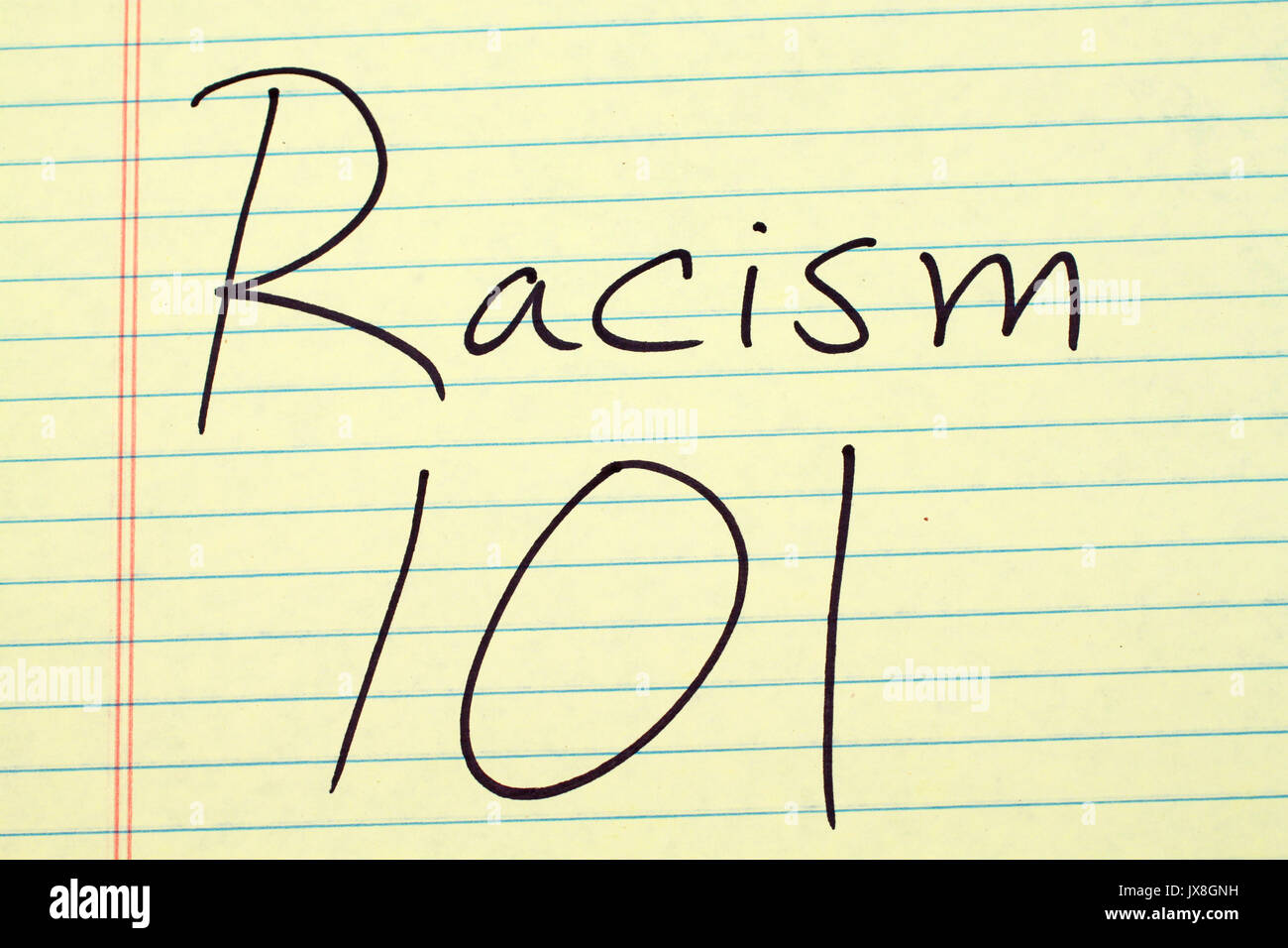 The words 'Racism 101' on a yellow legal pad - Stock Image