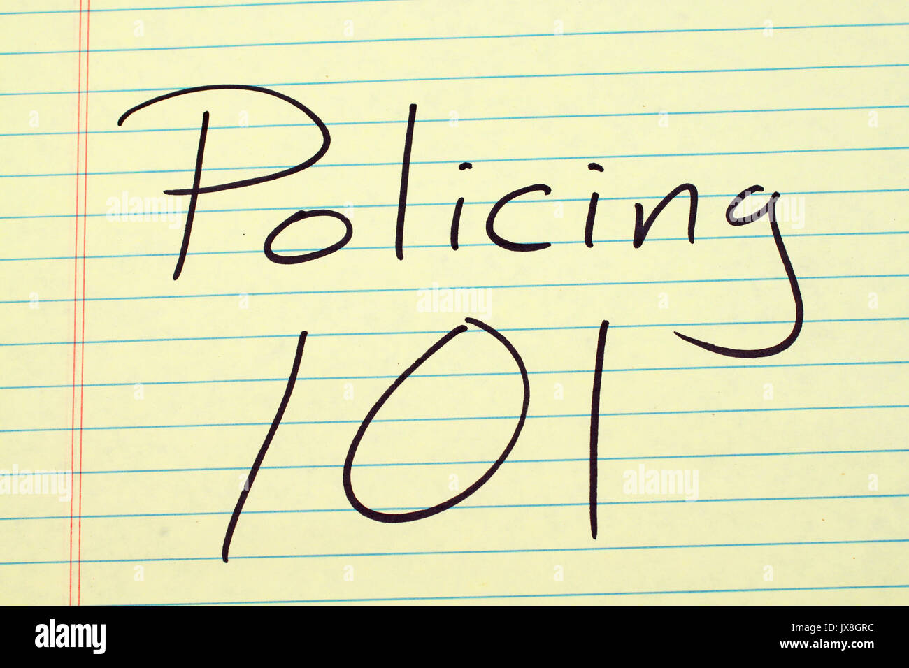 The words 'Policing 101' on a yellow legal pad - Stock Image