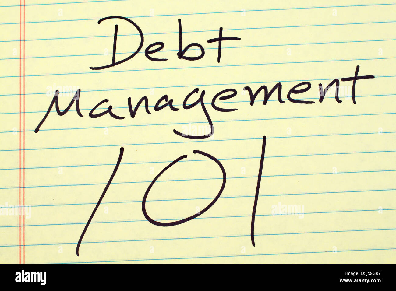 The words 'Debt Management 101' on a yellow legal pad - Stock Image