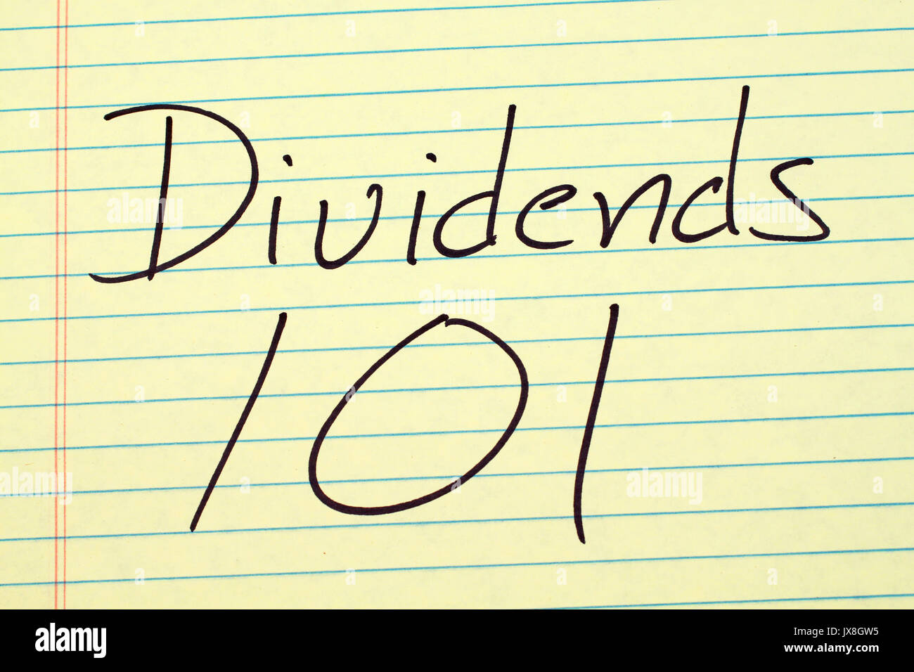The words 'Dividends 101' on a yellow legal pad - Stock Image