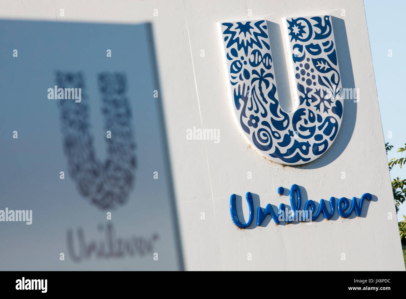 A logo sign outside of a facility occupied by Unilever in Newville, Pennsylvania on July 30, 2017. Stock Photo