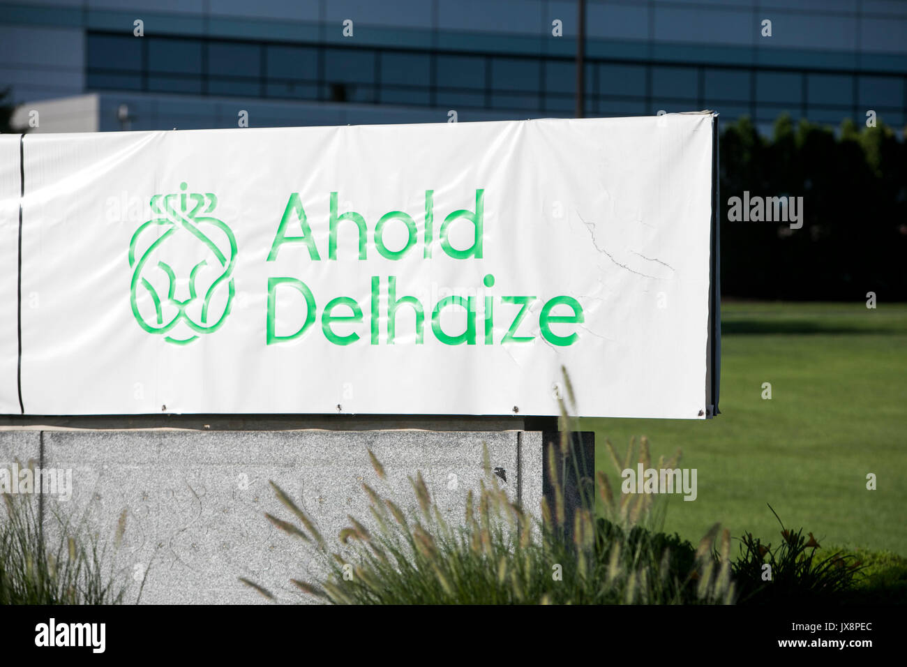 A logo sign outside of a facility occupied by Ahold Delhaize