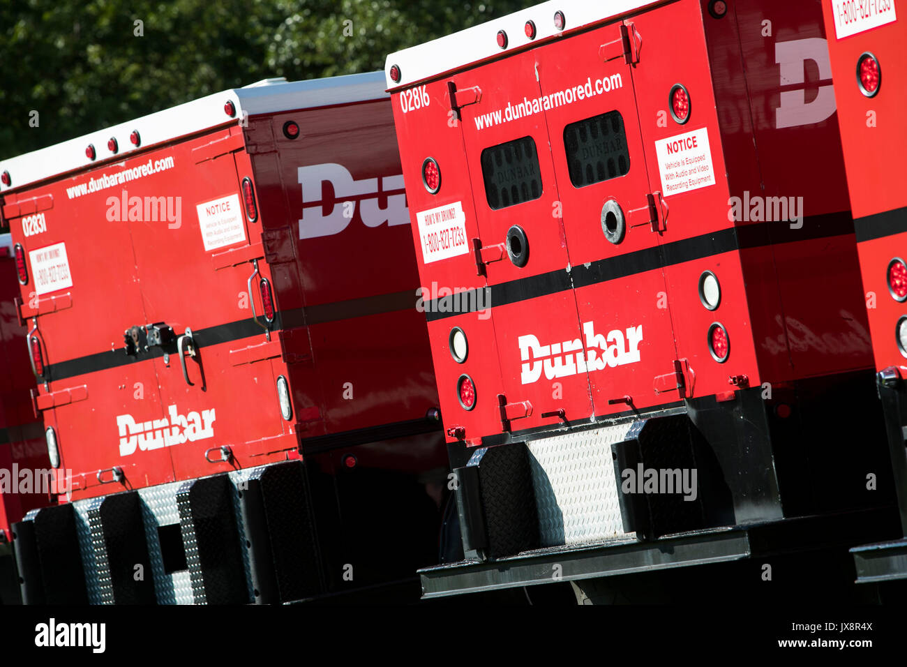 A row of Dunbar Armored trucks in Beltsville, Maryland, on August 13, 2017. - Stock Image