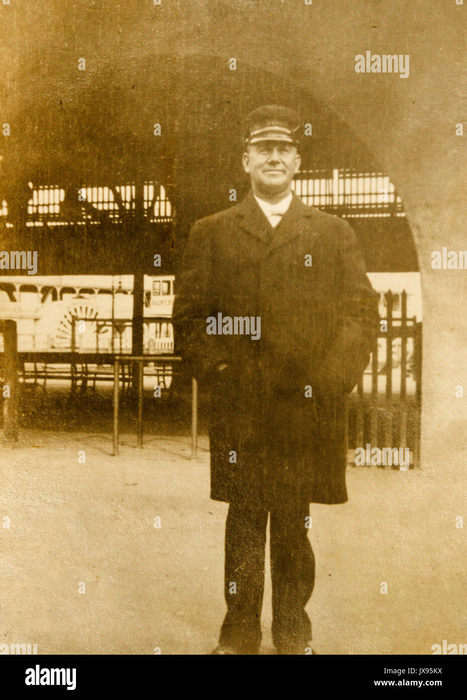 Possibly the Captain of a paddle wheel steamboat visible in the background in Minnesota 1907 1908 Stock Photo