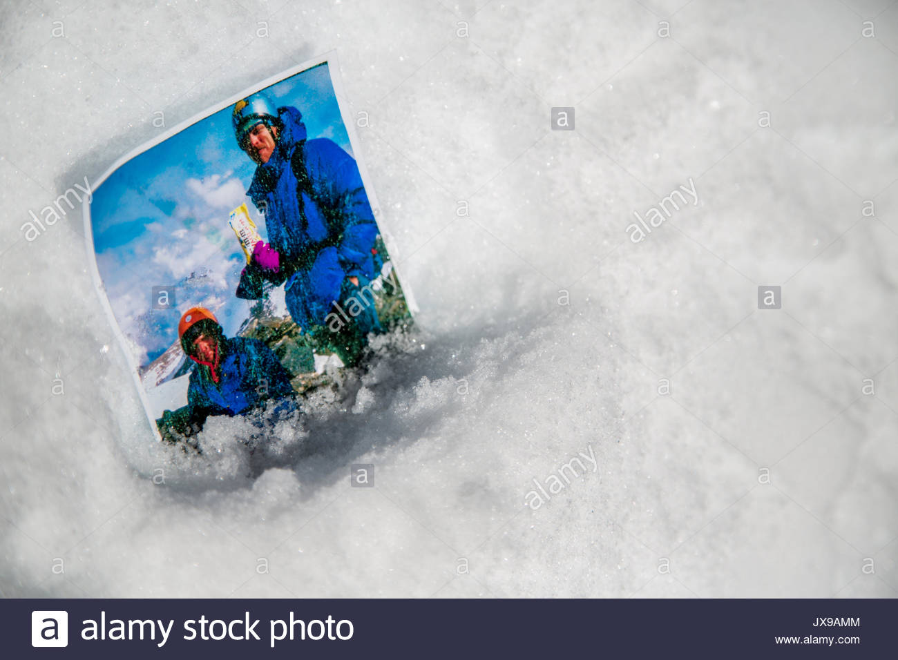 A photograph of an expedition team member's climbing partners, now deceased, left in the snow at the team's highpoint on Hkakabo Razi, said to be Southeast Asia's tallest mountain. - Stock Image