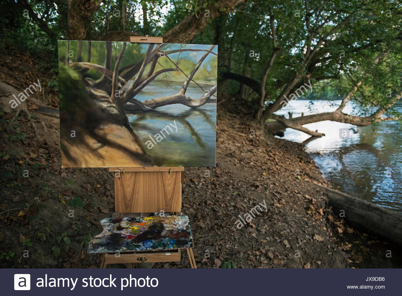 A plein air painting along the banks of the French Broad River. - Stock Image