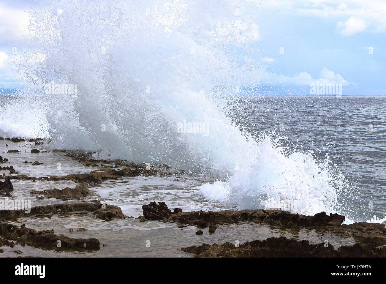 As Strong Waves Hits the Cliffs of Guiuan, Samar, Eastern Philippines, a splash of seawater emerges from the edge Stock Photo