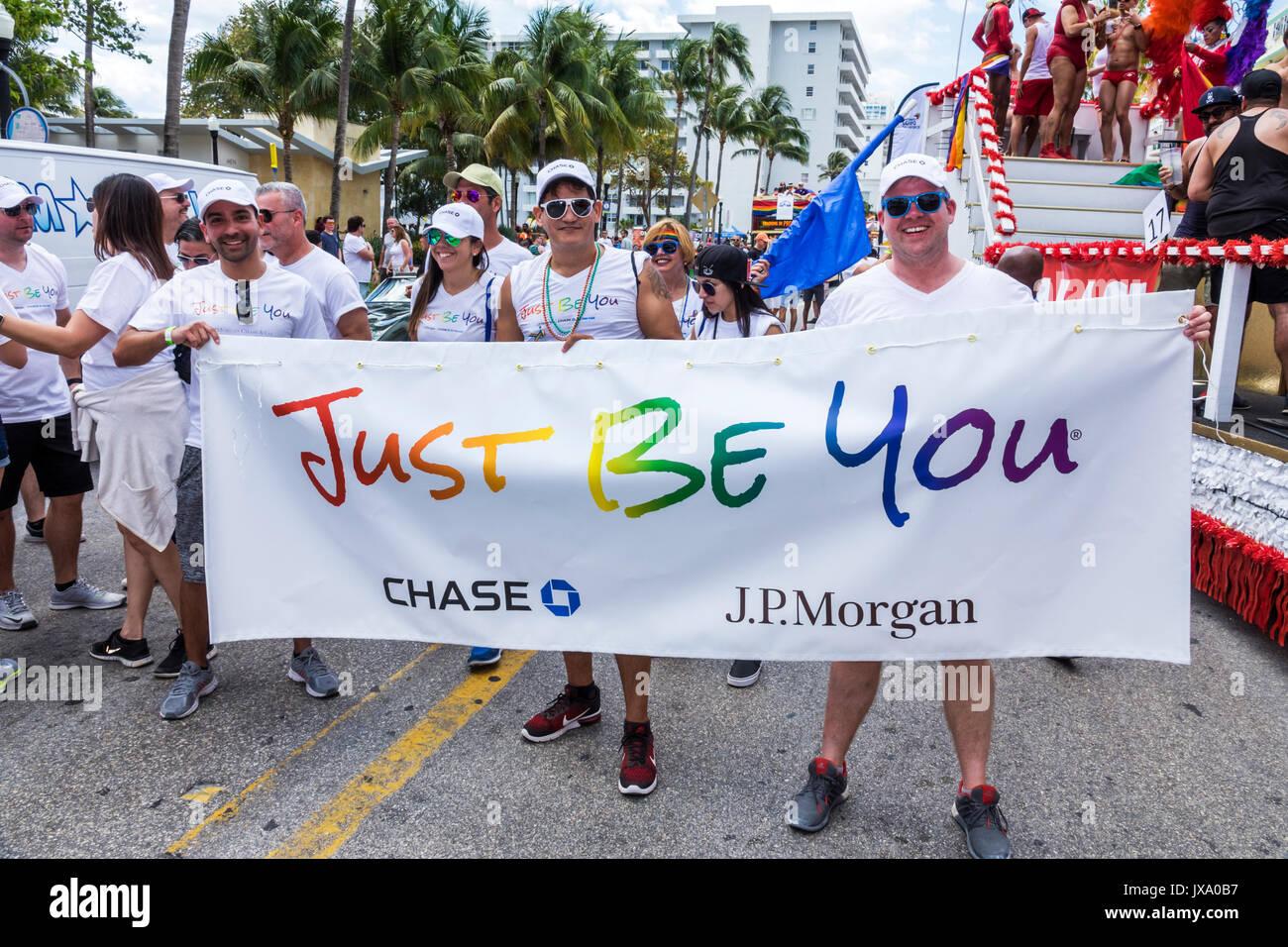 Miami Beach Florida Lummus Park Gay Pride Week LGBTQ LGBT Pride Parade participants staging area Chase JP Morgan Stock Photo