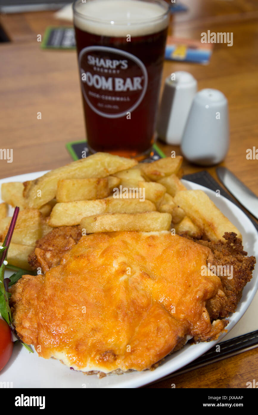 Chicken Parmo served for lunch in an English Country pub/bar/restaurant with a pint of real ale. - Stock Image
