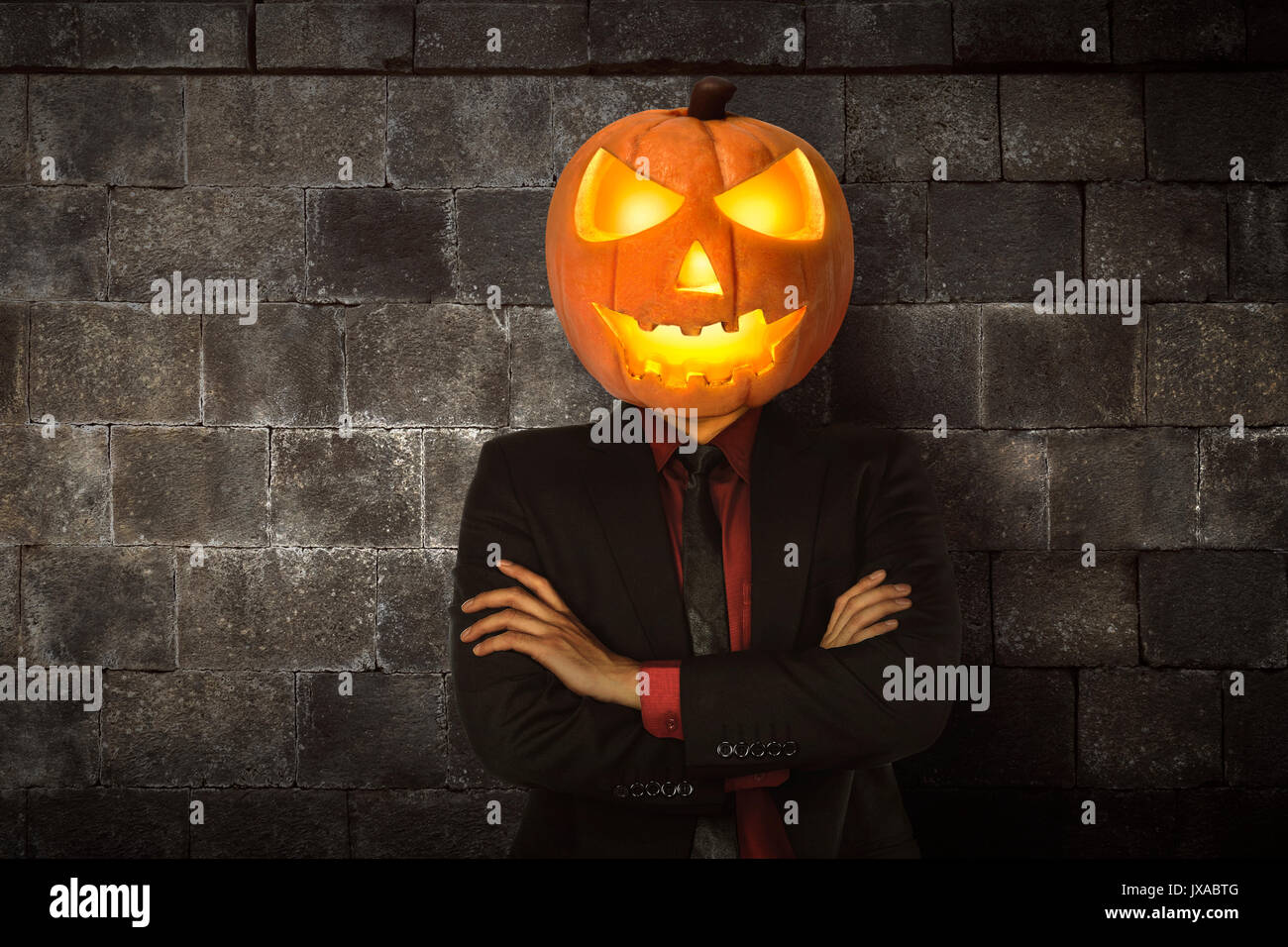 Halloween Maan.Young Halloween Man Wearing Suit With Pumpkin Head For