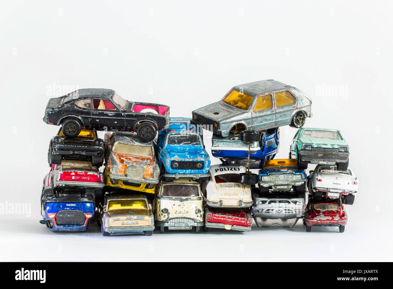 : Model car. A stack of broken toy cars. - Stock Image