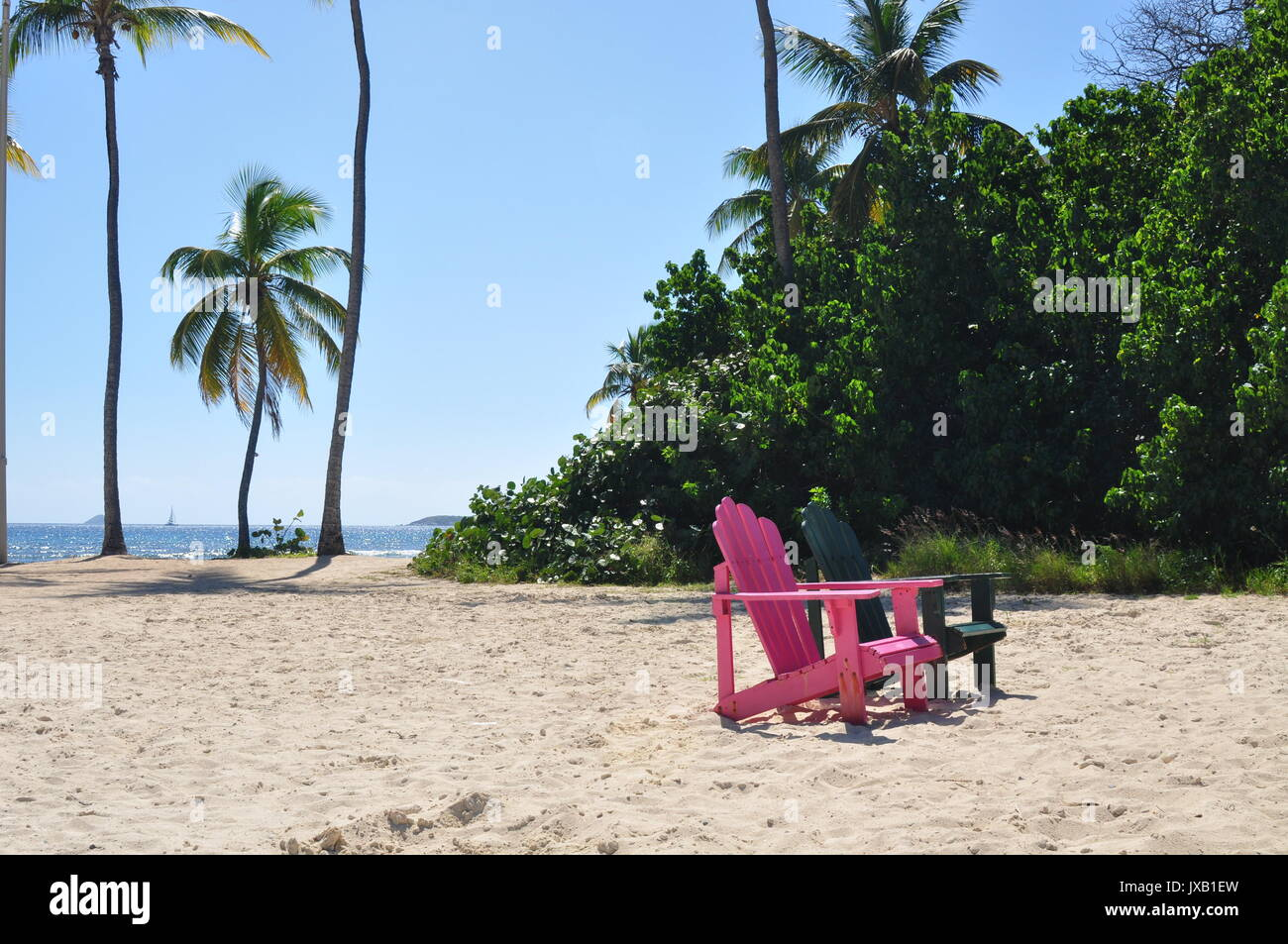Pink And Green Adirondack Chairs On The Beach In St. Thomas, US VI
