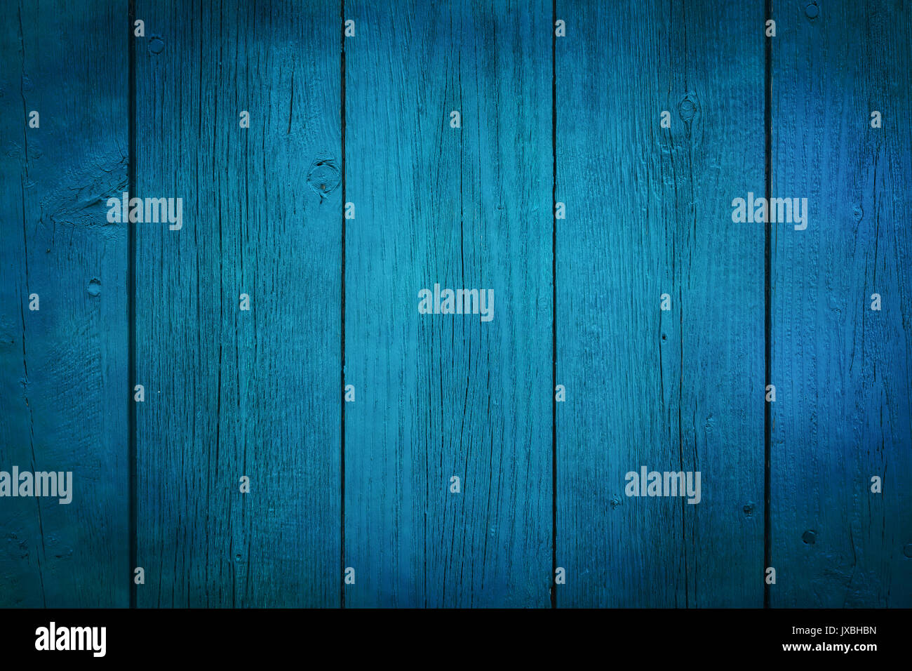 Bright blue painted board background. - Stock Image