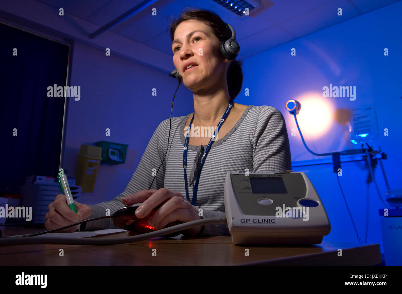 Michelle Davidson (Queen's Nurse) doing out-of-hours telephone triage at the GP Clinic, based at Weston General Stock Photo