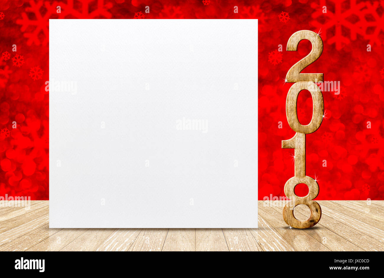 happy new year 2018 with blank white greeting card in perspective room at sparkling red snowflakes bokeh wall and wooden plank floorleave space for d