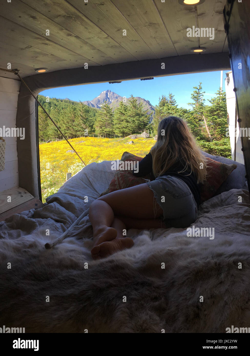 MEET the adventurous couple who packed up their life into a small van so they could travel and surf whenever they like. Incredible images and video fo - Stock Image