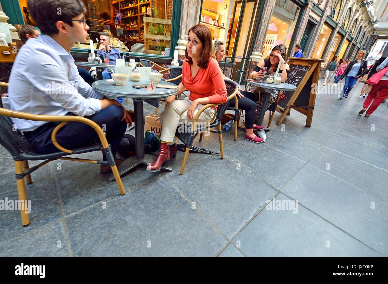 Brussels, Belgium. People sitting at cafe tables in Galeries Royales Saint-Hubert / Koninklijke Sint-Hubertusgalerijen Stock Photo