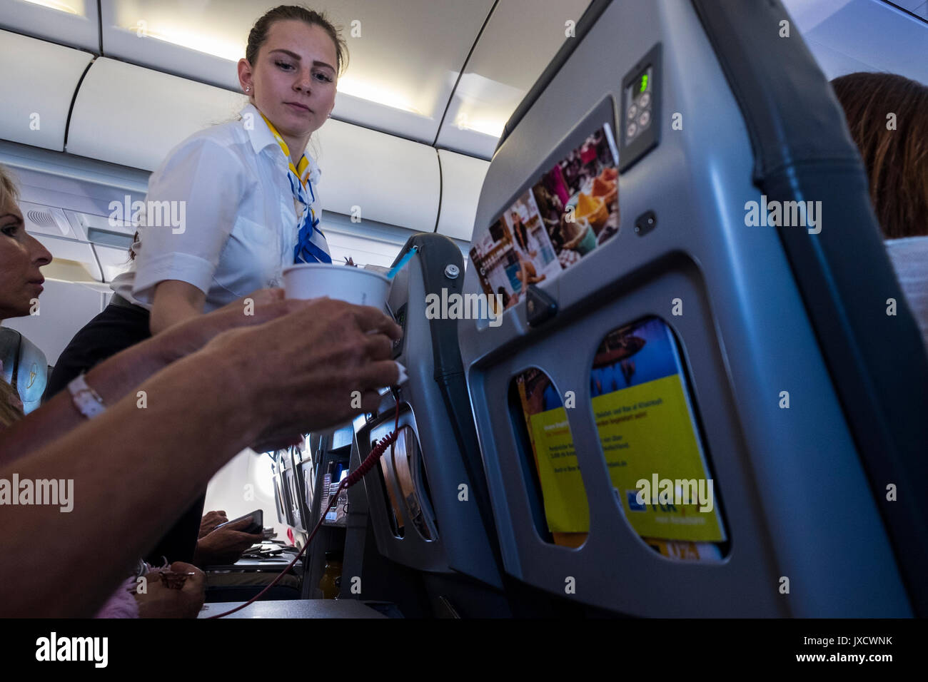Condor, Thomas Cook airlines, cabin crew selling drinks and snacks on board a flight - Stock Image