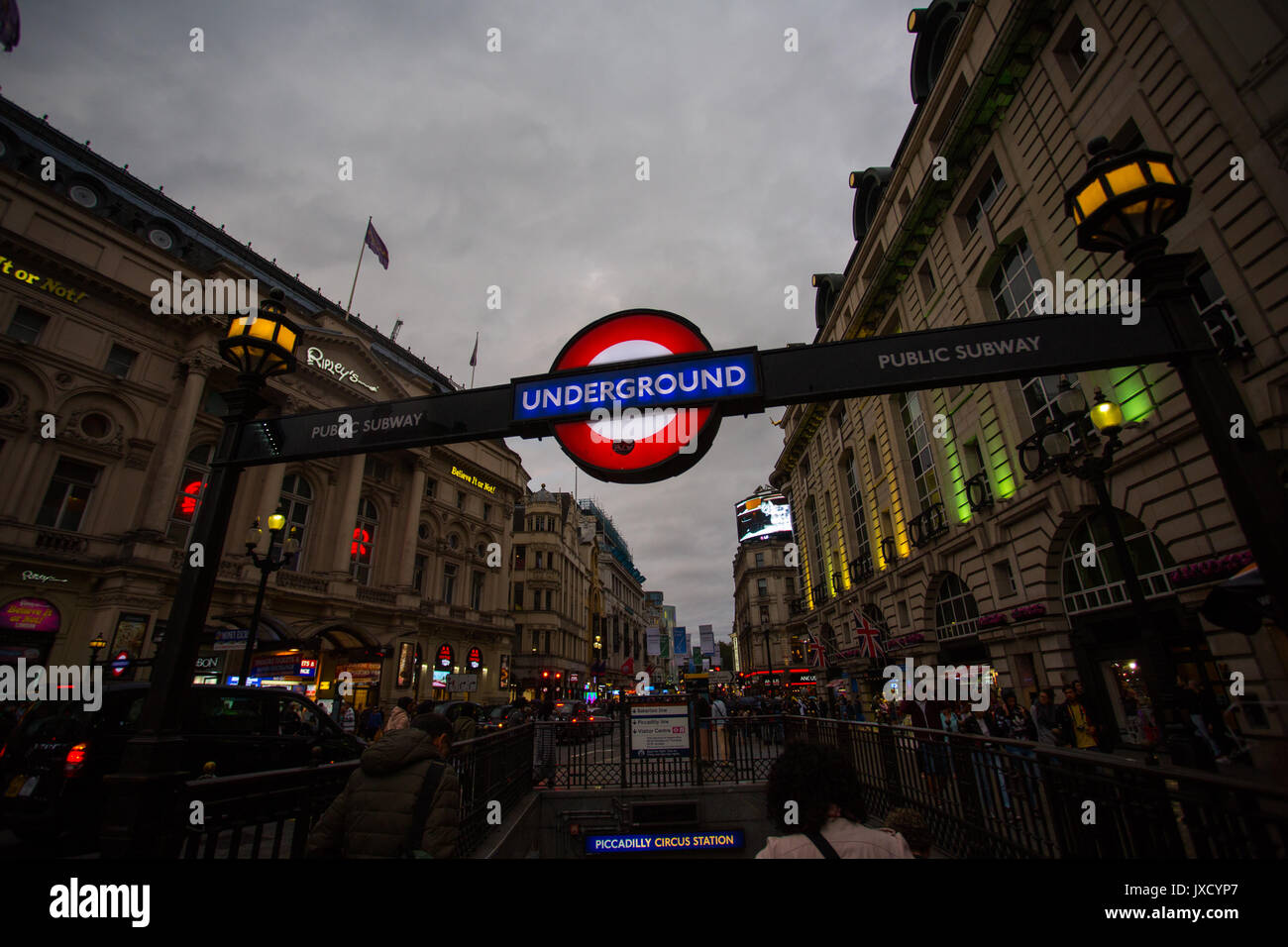 Entrance to the Underground and Public subway on an overcast day at Piccadilly Circus, London. - Stock Image