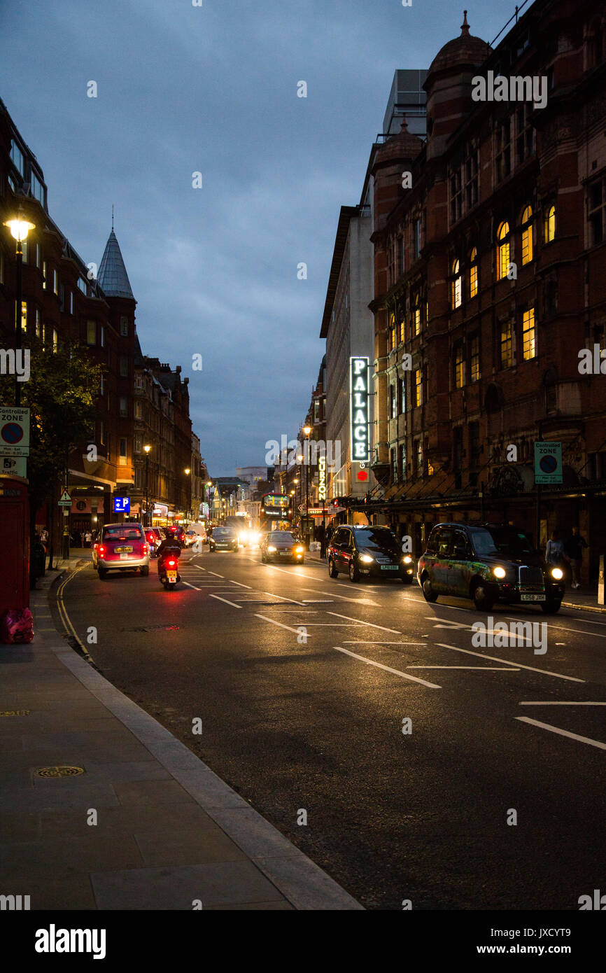 Evening Traffic on an overcast twilight evening by the Palace Theatre on Shaftesbury Avenue, London. - Stock Image