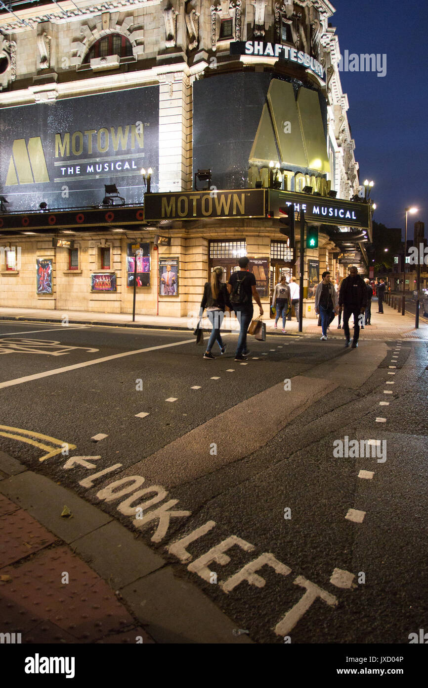 Road crossing leading to entrance of Shaftesbury Theatre playing Motown on Shaftesbury Avenue, London UK. - Stock Image