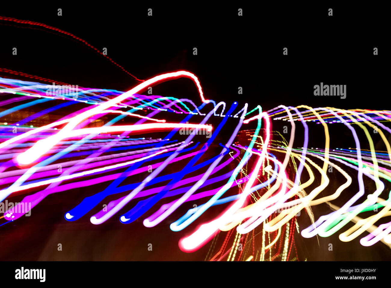 abstract background of traced lights in the dark - Stock Image