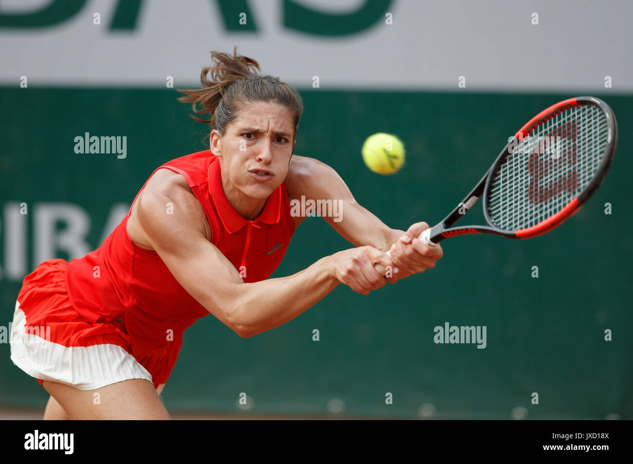 ANDREA PETKOVIC (GER) playing backhand return at the French Open. - Stock Image