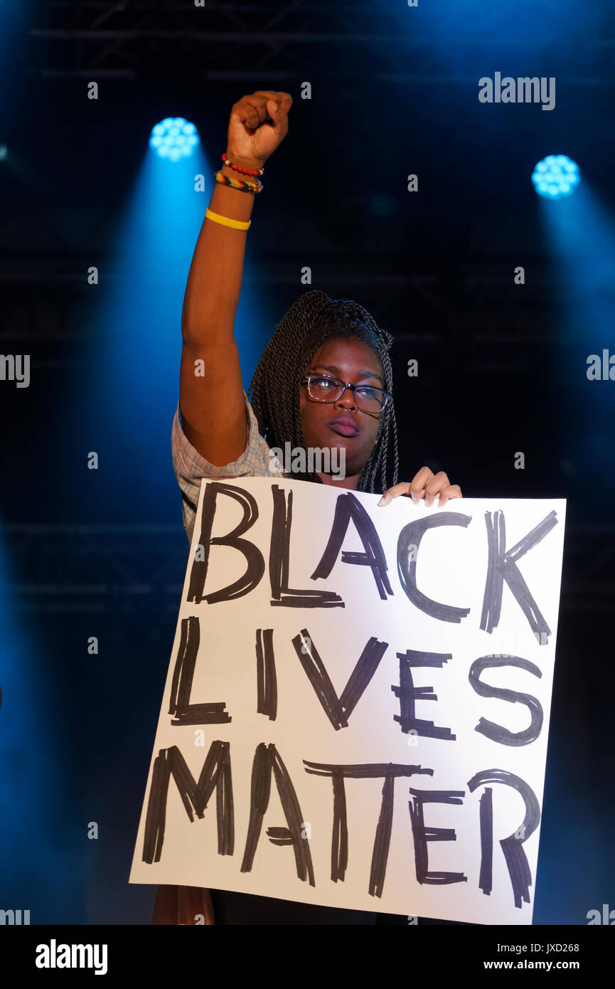 Montreal, Canada 14/08/2017 . A young black woman holds a Black Lives Matter sign on stage at the QTBIPOC Excellence show held during Montreal Pride W - Stock Image