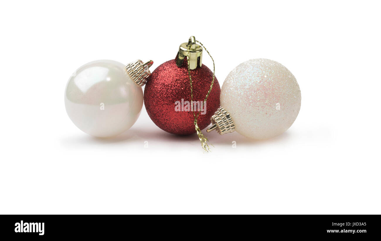 5943dea33d6e Red and white shiny glitter christmas baubles isolated on a pure white back