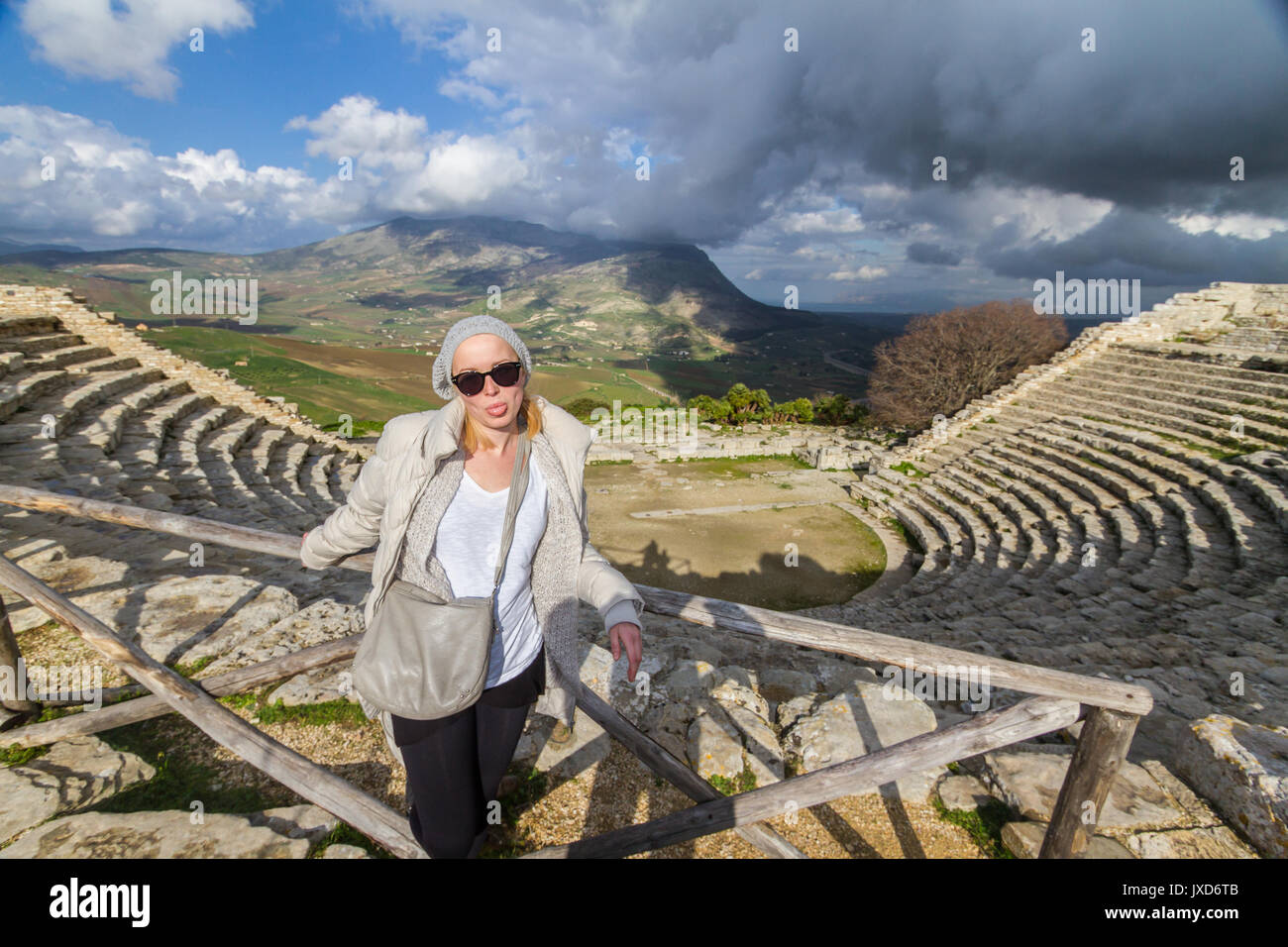 Tourist taking photo in front of greek theater of Segesta, Sicily, Italy Stock Photo