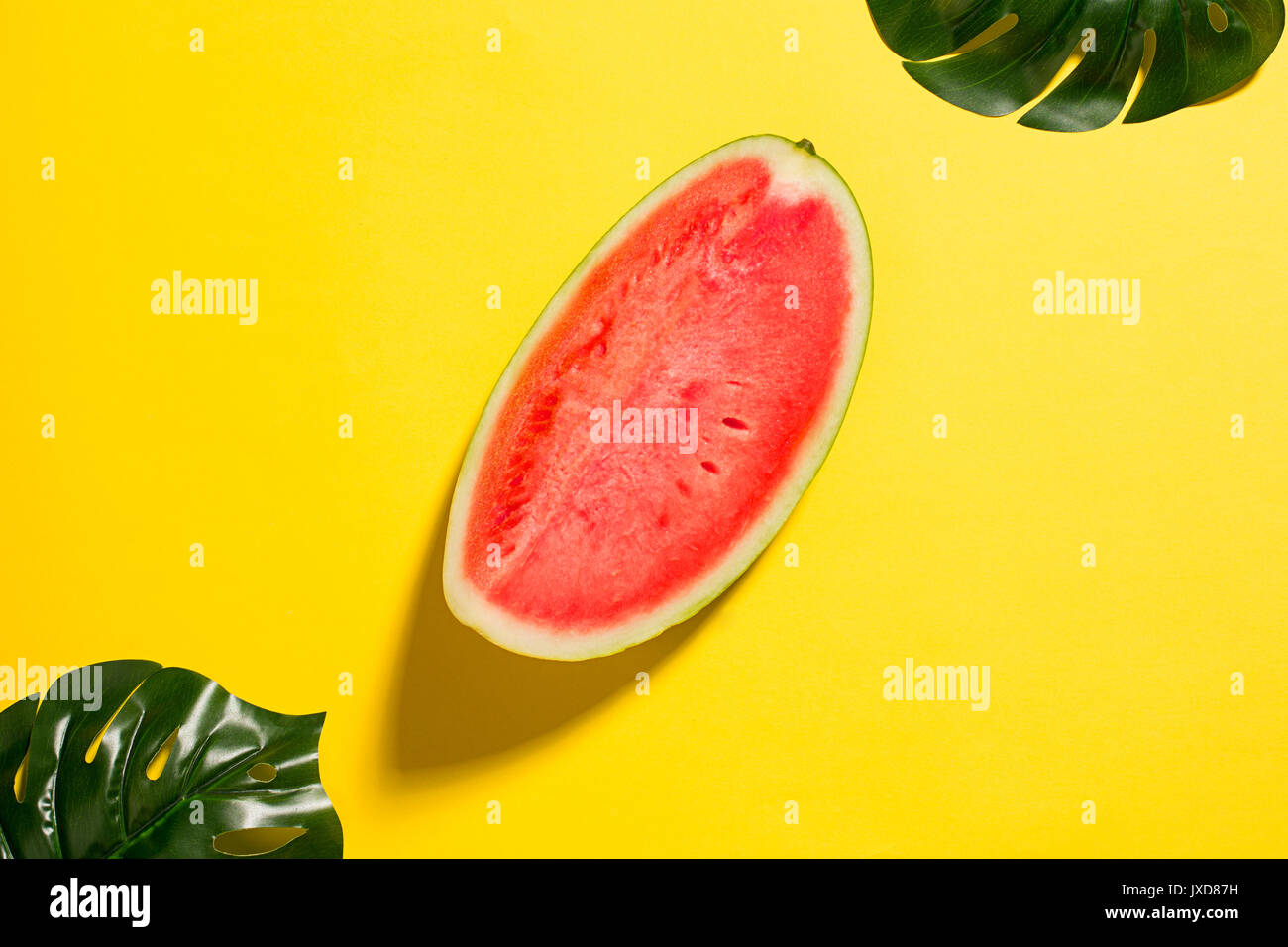 Watermelon on yellow background - Stock Image