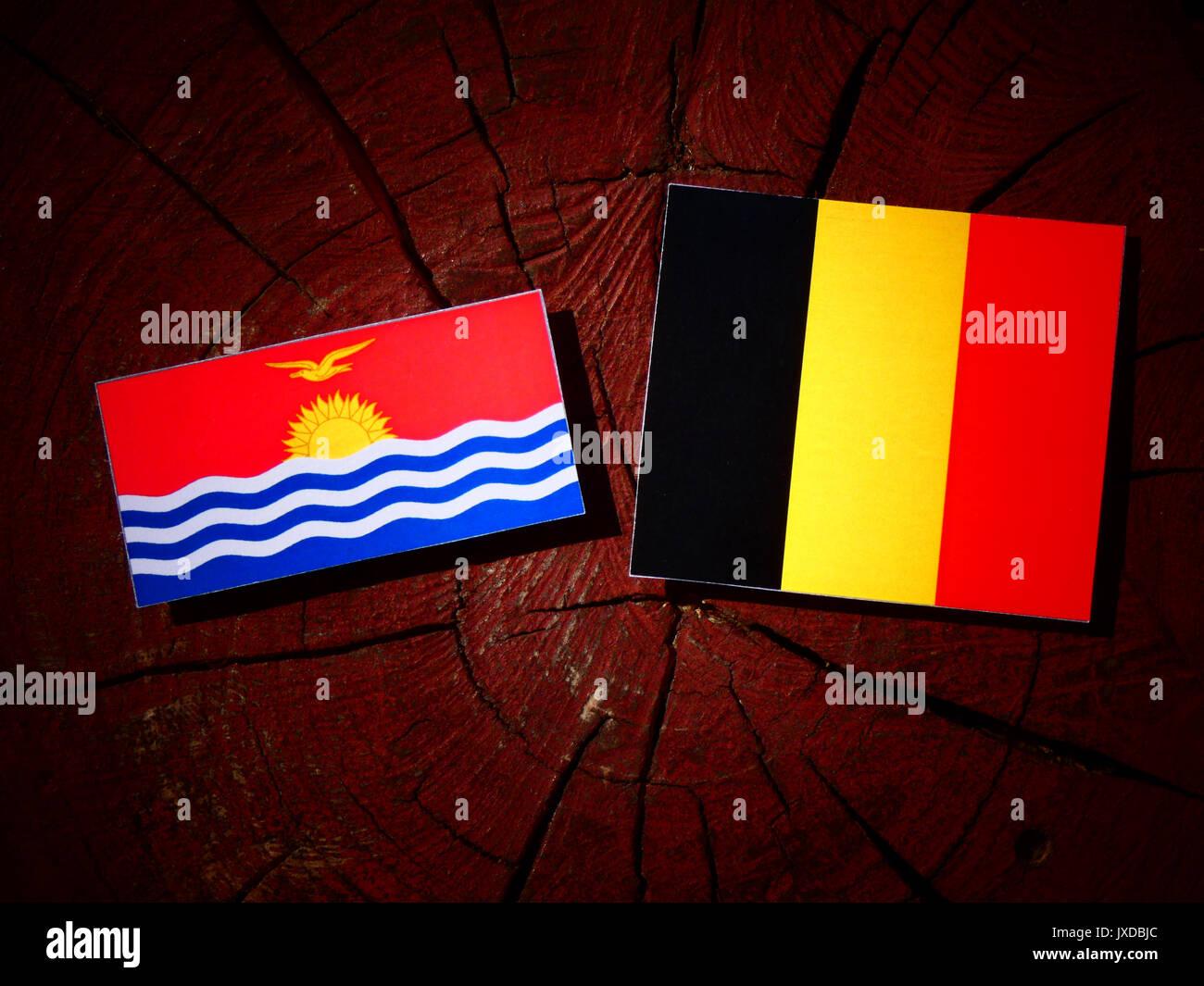 Kiribati flag with Belgian flag on a tree stump isolated - Stock Image
