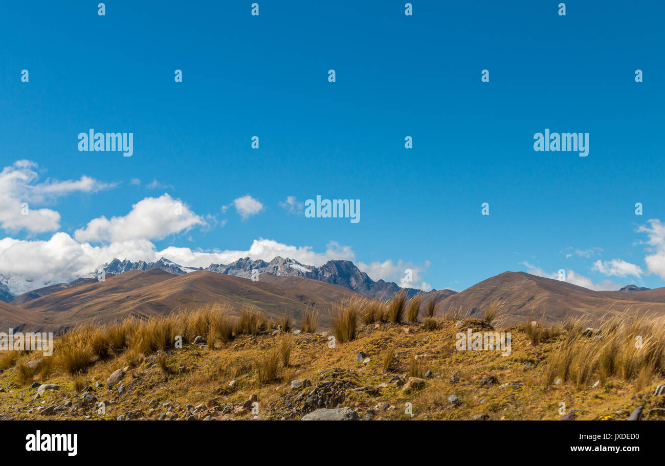 snow topped mountain peaks in the distance - Stock Image