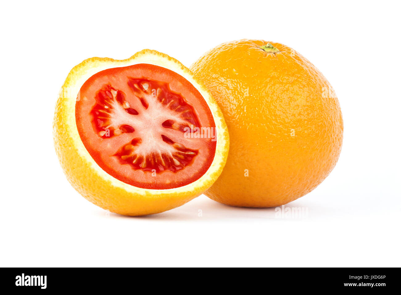 Creative photo manipulation of sliced orange with red tomato inside isolated on white background - Stock Image