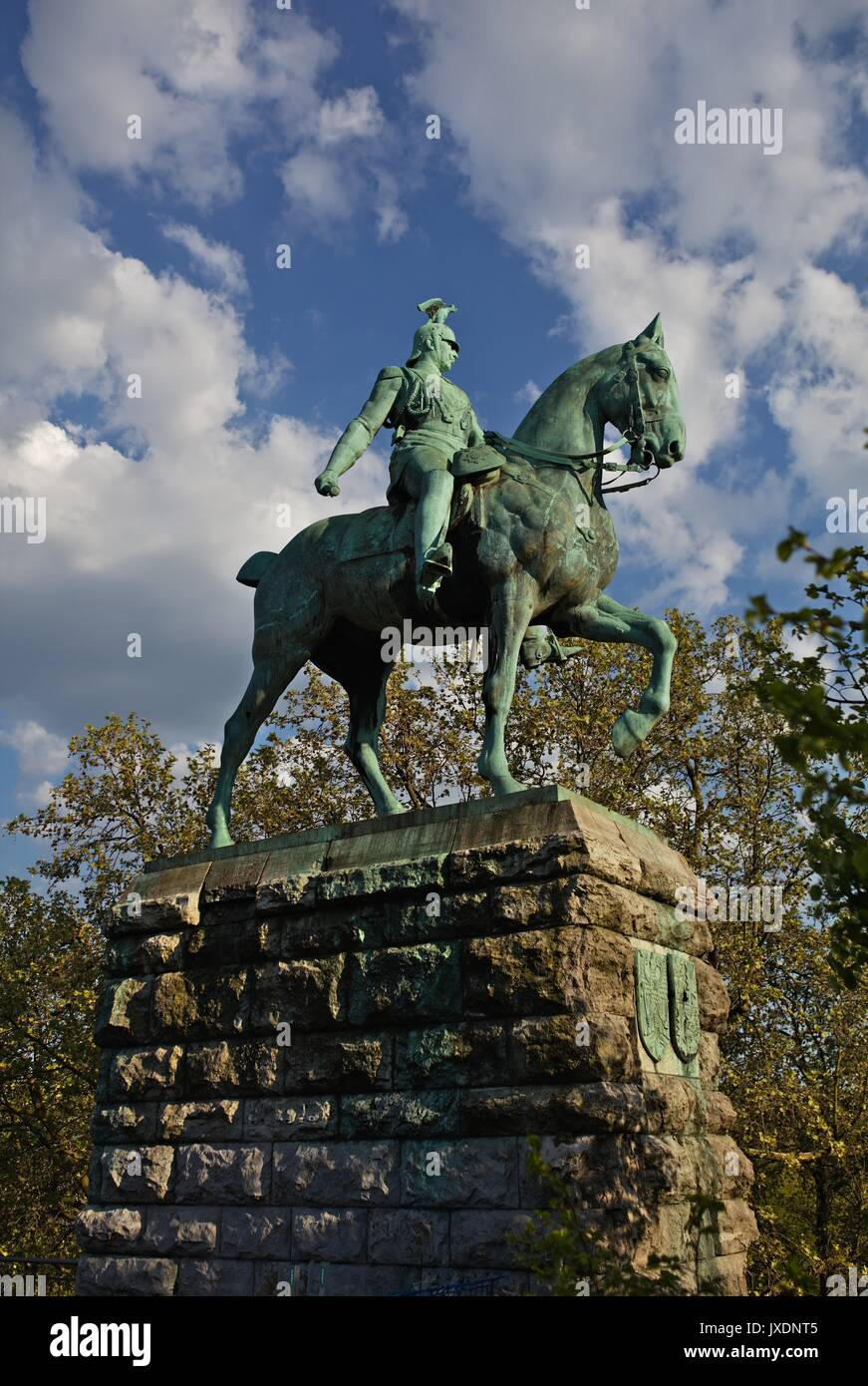 Statue of Emporer Wilhelm II on left bank of river Rhine and the south side of the Hohenzollern railway bridge in Cologne, Germany - Stock Image