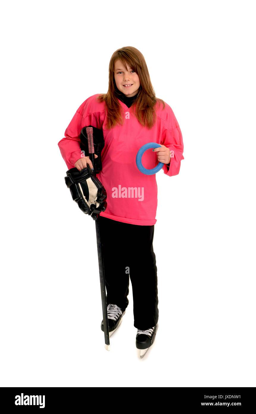 Girl with ringette equipment for winter ice sport - Stock Image