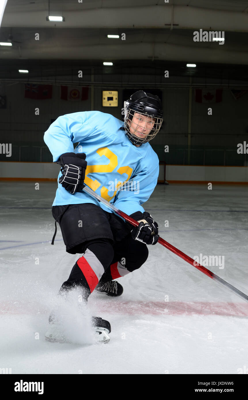 A Teen Age Hockey Player Makes Sharp Stop in the Rink - Stock Image