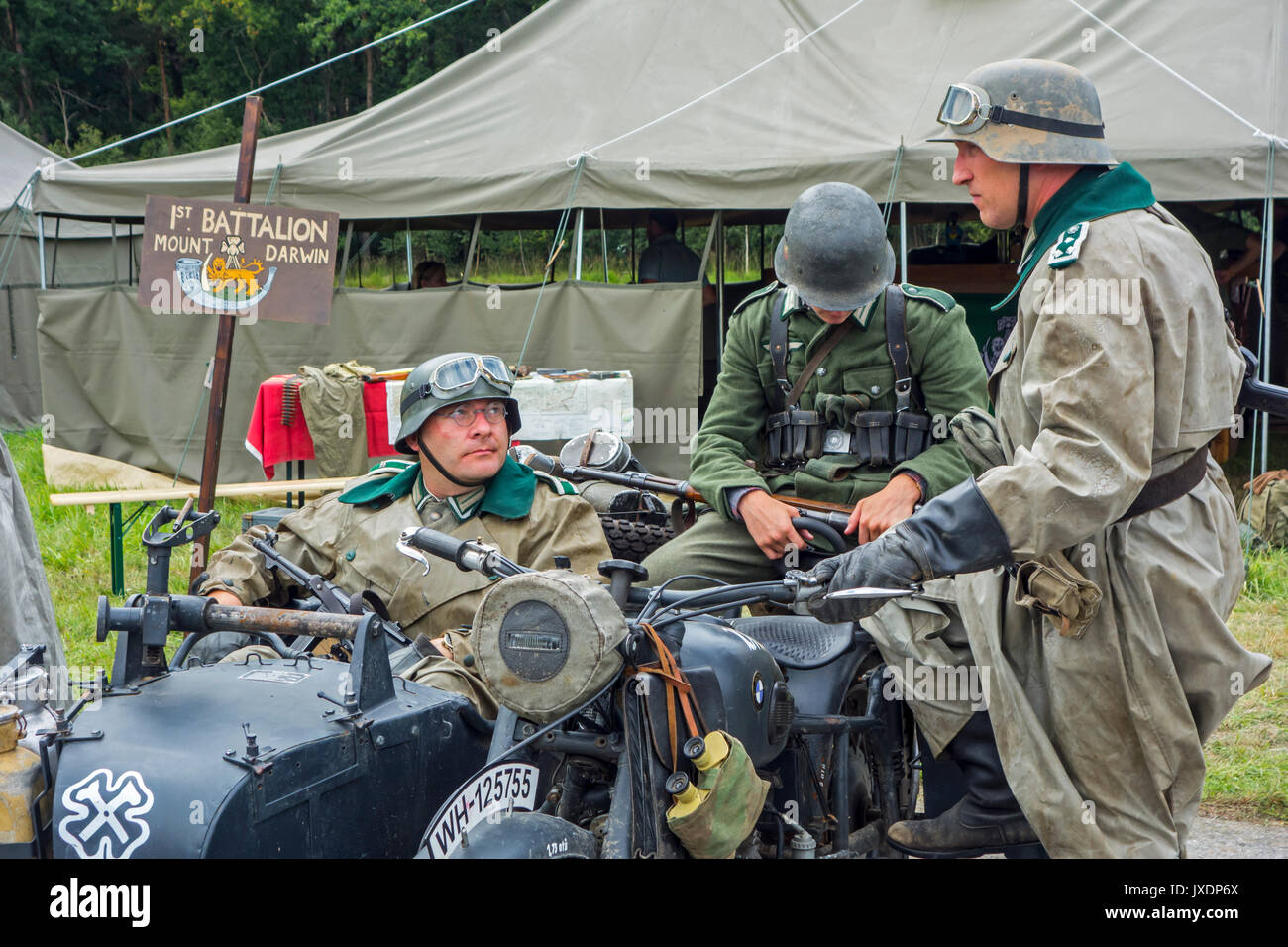 Re-enactors in German WW2 soldier outfits on BMW military motorcycle with sidecar during World War Two re-enactment at militaria fair - Stock Image