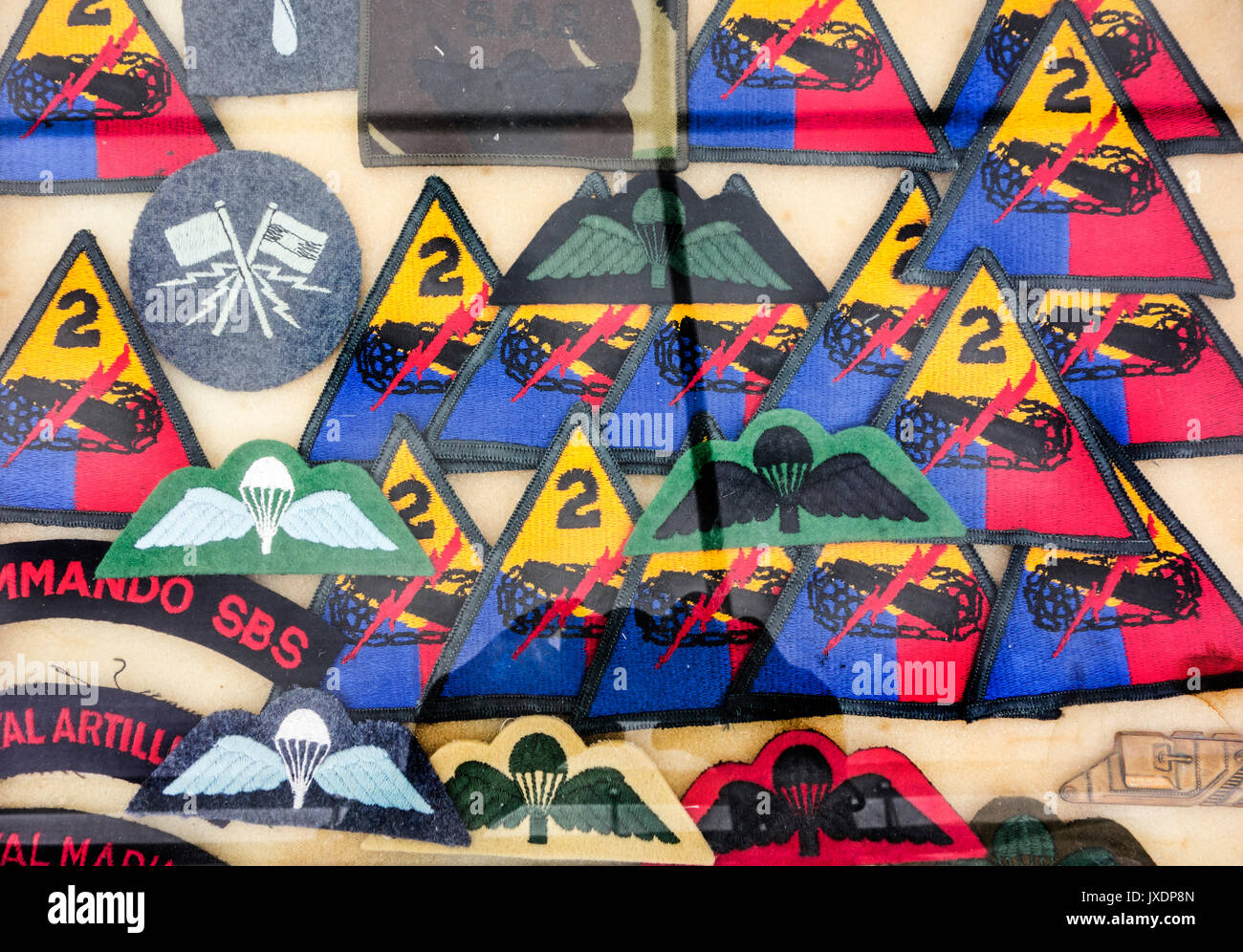 Assortment of military insignias for sale at militaria fair - Stock Image
