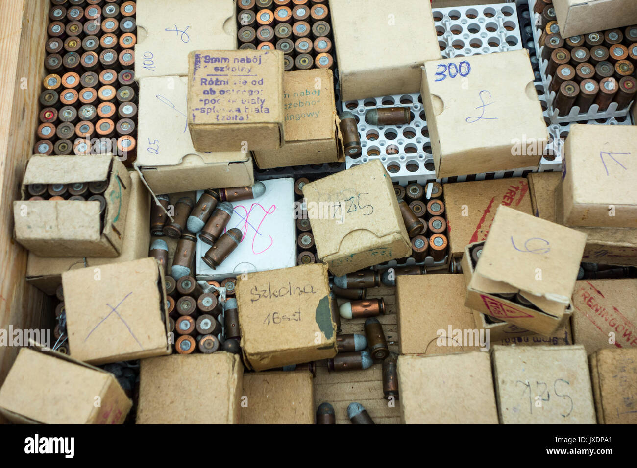 Boxes with 9 mm bullets for sale at militaria fair - Stock Image