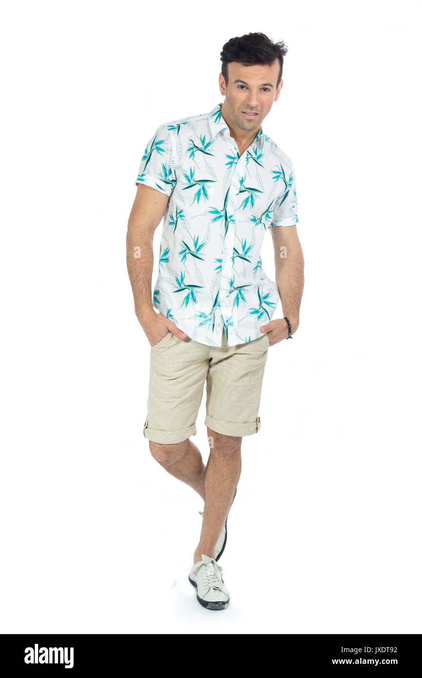 5623c4cb254 Brazilian male wearing a Hawaiian style floral shirt and beige shorts.  Summer