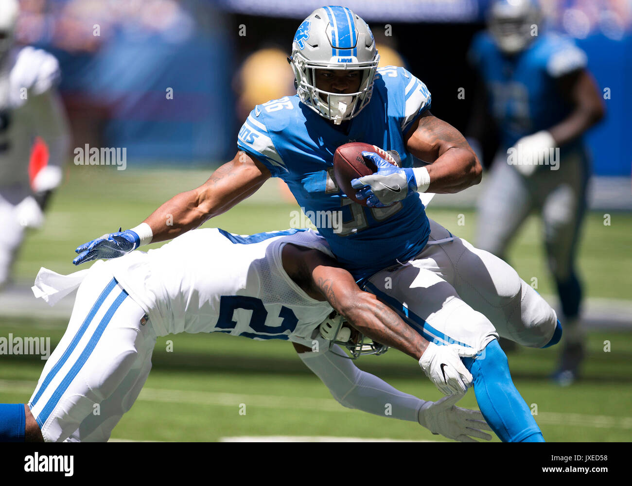 fcbbb1a86 ... running back Dwayne Washington (36) runs with the ball during NFL  football pre-season game action between the Detroit Lions and the Indianapolis  Colts ...
