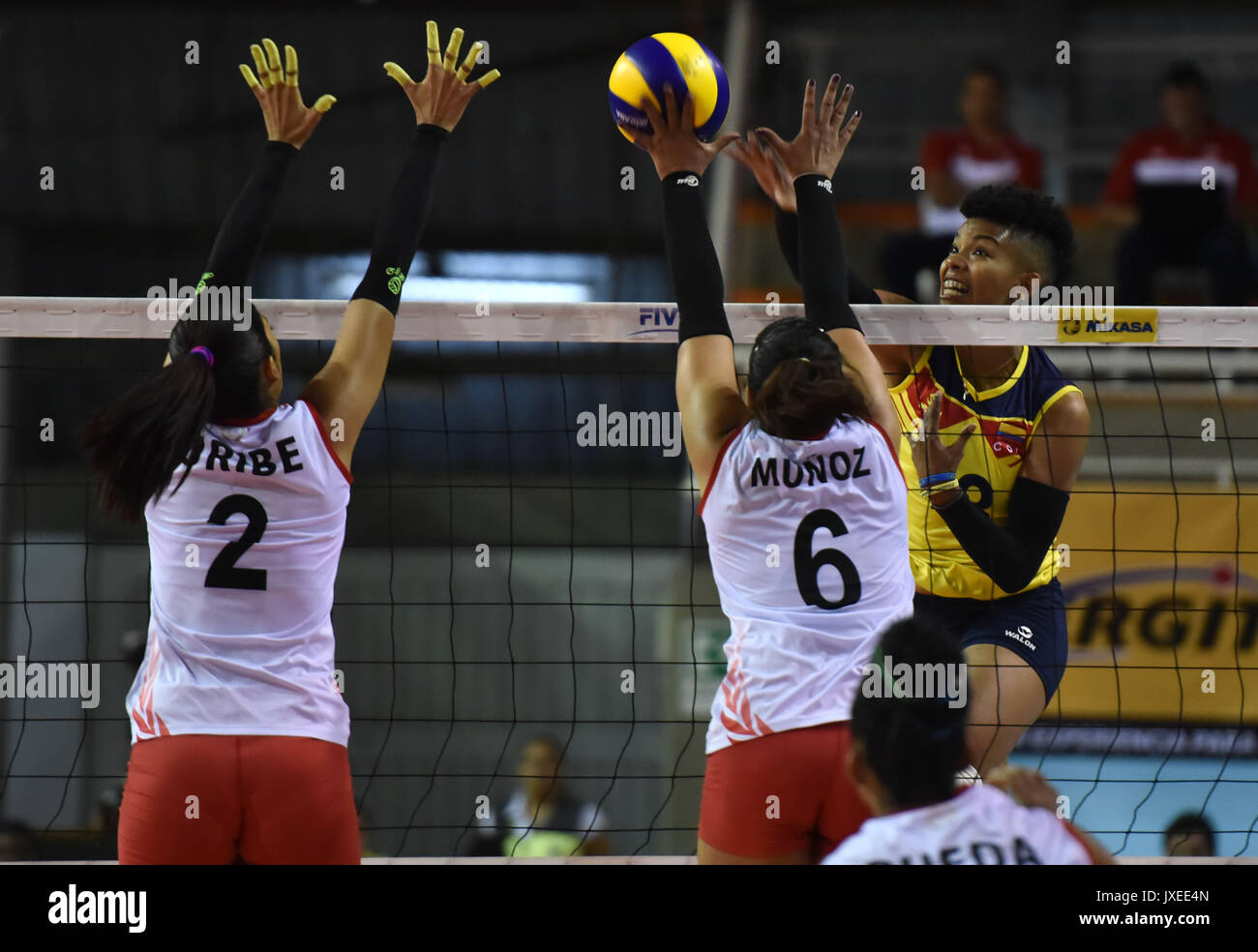 97cb2dcea Colombia s Margarita Martínez (R) in action against Peru s Mirtha Uribe (L)  and