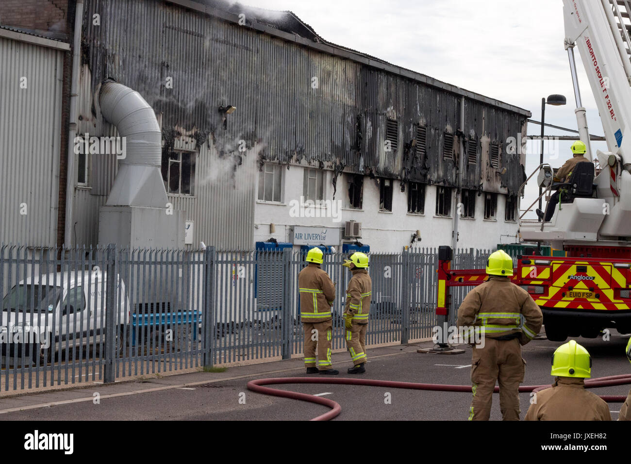 Southend on sea, Essex, UK. 16th August 2017. Airport Fire. A large fire has broken out at the Air Livery hangar based at London Southend Airport at around 11:00 AM Fire crews were quick to respond to the incident. Credit: Darren Attersley/Alamy Live News Stock Photo