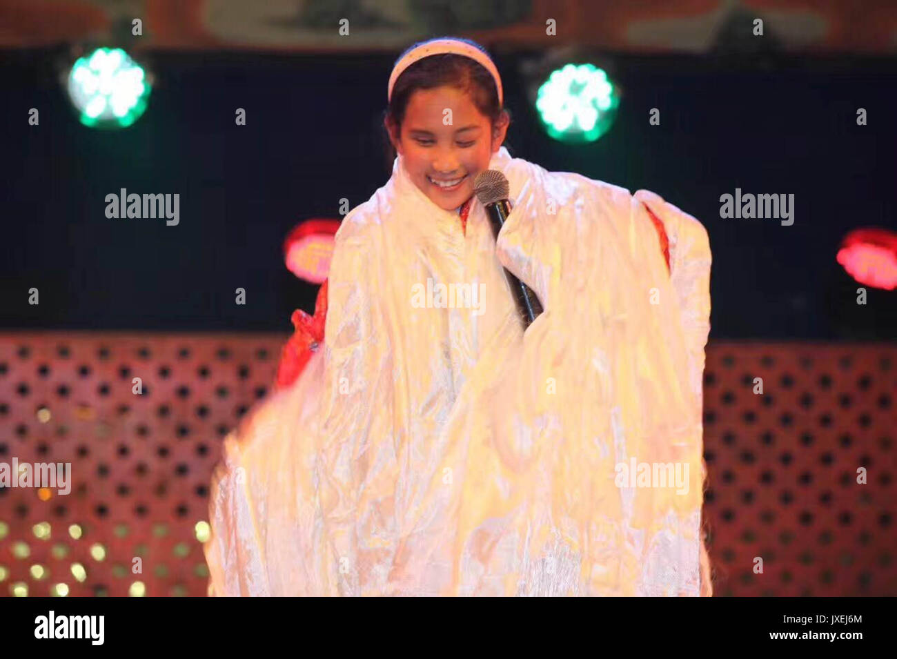 (170816) -- XIAHE, Aug. 16, 2017 (Xinhua) -- File photo taken in 2009 shows Deqen Yuzhen covered with hadas after performing at a party in the school for blind children at southwest China's Tibet Autonomous Region. Deqen Yuzhen, who was born on Sept. 14, 1998, is the daughter of a herdsman family in Maqu County, Gannan Tibetan Autonomous Prefecture, northwest China's Gansu Province. Unfortunately she lost her sight due to a serious illness when she was a baby. She was sent to the school for blind children in southwest China's Tibet Autonomous Region at the age of nine and transferred to blind - Stock Image