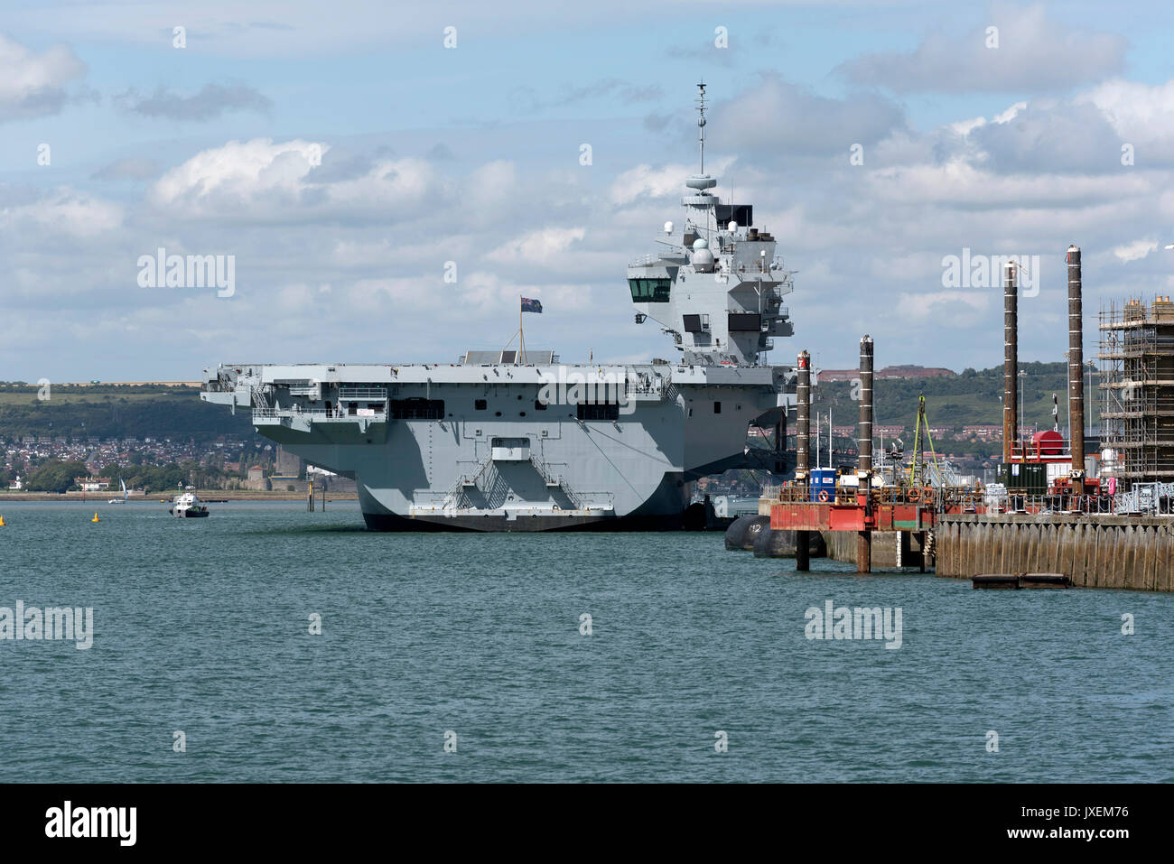 Portsmouth, UK. 16th Aug, 2017. Royal Navy Dockyard with aircraft carrier HMS Queen Elizabeth alongside the Princess Royal jetty. - Stock Image