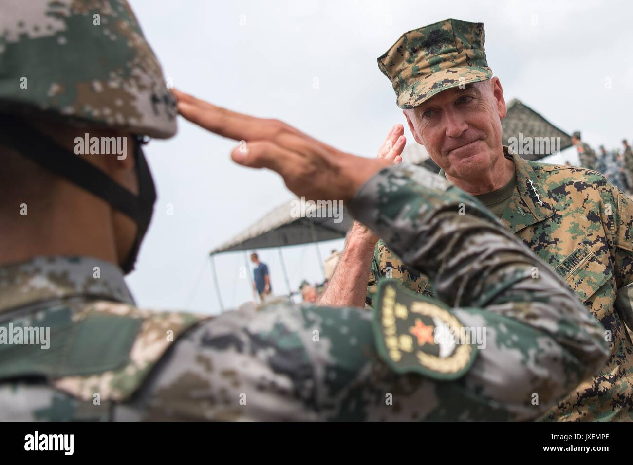 Haichung, China. 16th Aug, 2017. U.S. Chairman of the Joint Chiefs Gen. Joseph Dunford, center, salutes a Chinese Stock Photo