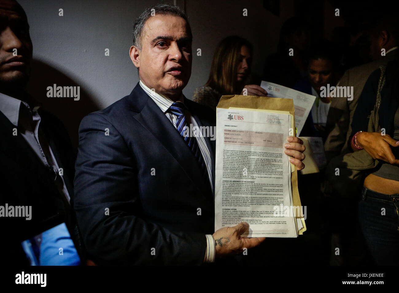 Caracas, Venezulea. 16th Aug, 2017. Venezuelan Attorney General Tareck William Saab shows evidence of bank accounts in dollars opened in the Bahamas, allegedly linked to a extorsion network inside the Attorney's Office, in Caracas, Venezuela, 16 August 2017. Saab demanded the incarceration of deputy German Ferrer, husband of his predecessor Luisa Ortega, minutes after a group of officialist constituents demanded the clearance of his parliamentary immunity and arrest. Credit: EFE News Agency/Alamy Live News - Stock Image